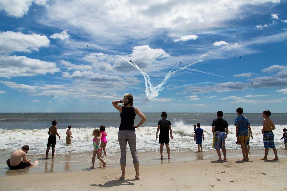 Spectators look on as the GEICO Skytypers take