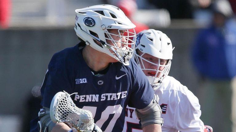 Penn State's Gerard Arceri wins a faceoff and