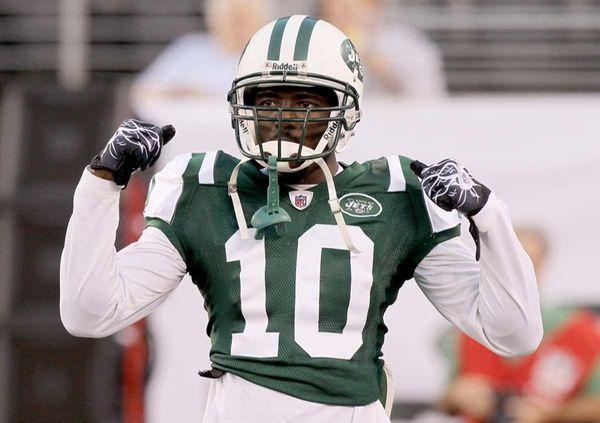 Santonio Holmes of the Jets looks on before