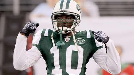 Santonio Holmes of the Jets looks on before