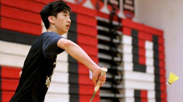 Commack's Andrew Wang returns the back hand volley