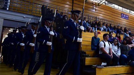 An Air Force honor guard enters a high