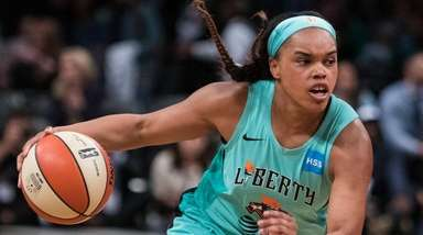 Liberty guard Asia Durr drives past China National