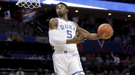 Duke's RJ Barrett goes up to dunk against