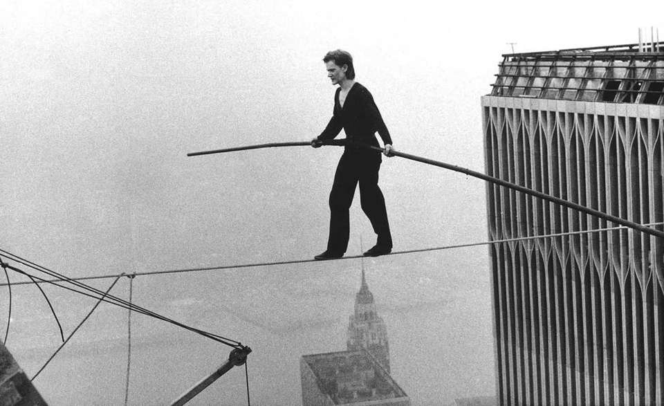 Philippe Petit, a French high wire artist, walks