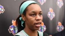 Liberty guard Asia Durr speaks to the press
