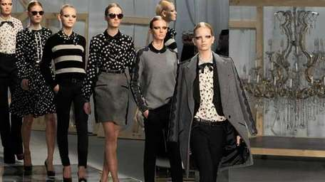 Models walk the runway at the Jason