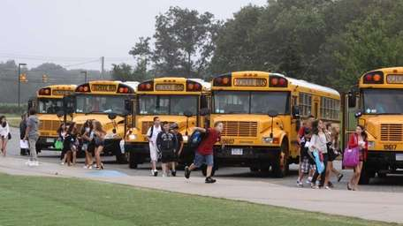 Students are dropped off by bus at Nesaquake