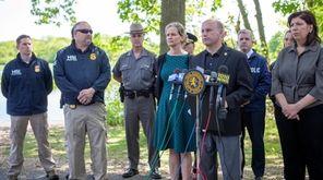 Nassau County Police Commissioner Patrick Ryder, flanked by