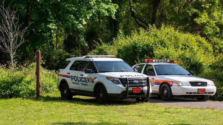 Nassau police at the Massapequa Preserve on Saturday.