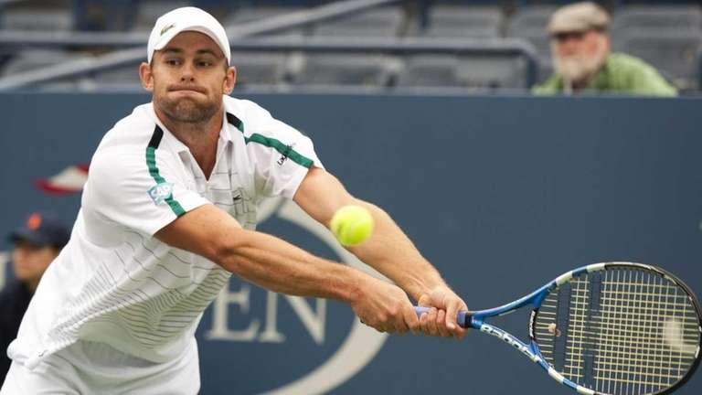 Andy Roddick hits a return during his men's