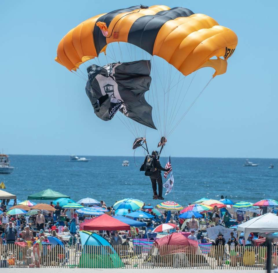 The US Army Golden Knights floating down from