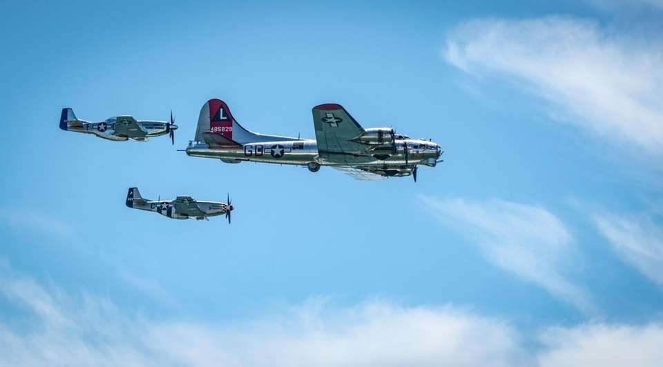 The warbirds taking a pass over the beach
