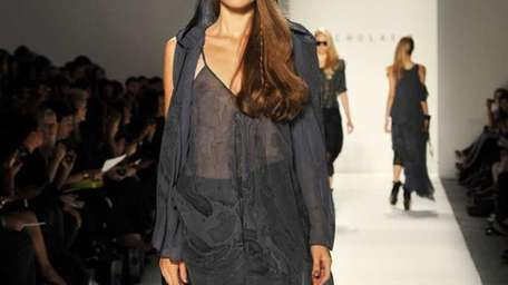 A model walks the runway at the Nicholas