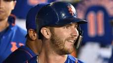Mets first baseman Pete Alonso looks on from