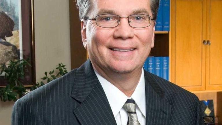 Donald P. Astrab, president of Nassau Community College,