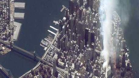 Satellite image of lower Manhattan shows smoke and