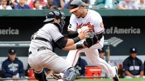 Nick Markakis #21 of the Baltimore Orioles collides