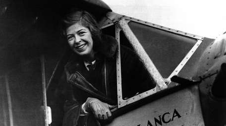 Elinor Smith smiling from the cabin of her