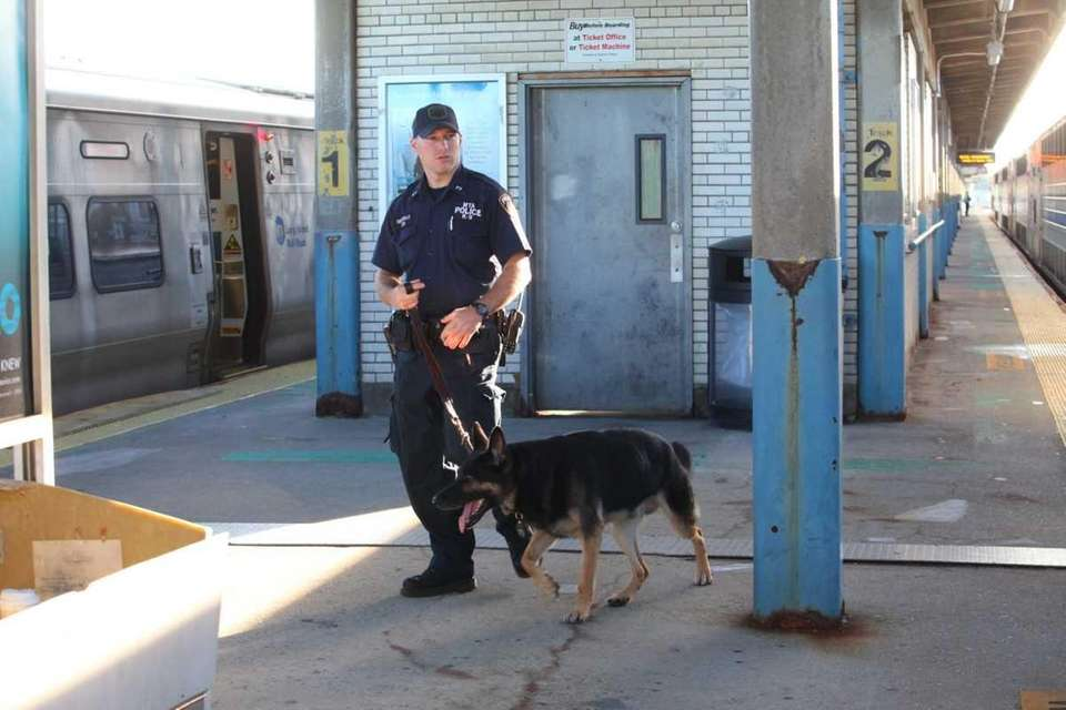 An MTA K-9 unit checks the Hicksville LIRR