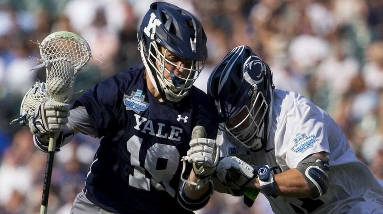 Jack Tigh #18 of Yale Bulldogs controls the