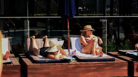 Poolside patrons at The Montauk Beach House.