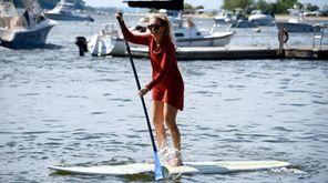 Christina Losquadro, 29, of Long Beach paddles back