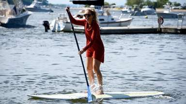 Christina Losquadro, 29, of Long Beach paddles back