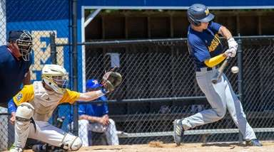 Massapequa no. 24 Travis Honeyman hits a double