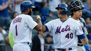 Wilson Ramos #40 of the Mets celebrates his