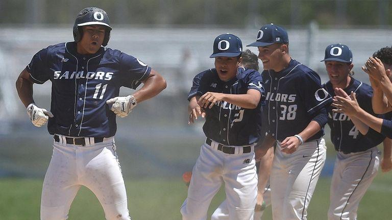 Leo Alvarez #11 of Oceanside. left, gives teammates