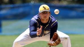 Shoreham's second baseman Nick Bettenhauser (8) follows the