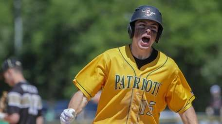 Matthew Franco #15 of Ward Melville celebrates as