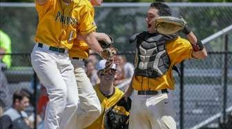 Ward Melville players celebrate after defeating Commack at