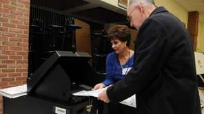 A voter is given instruction on how to