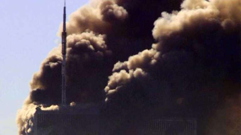 Smoke billows from the Twin Towers of the
