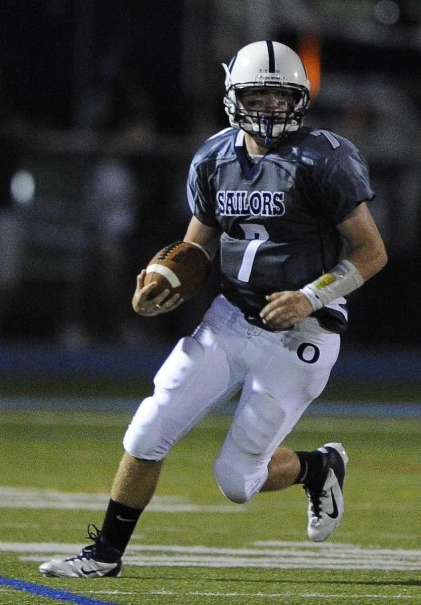 Oceanside quarterback John Grassi runs for yardage against