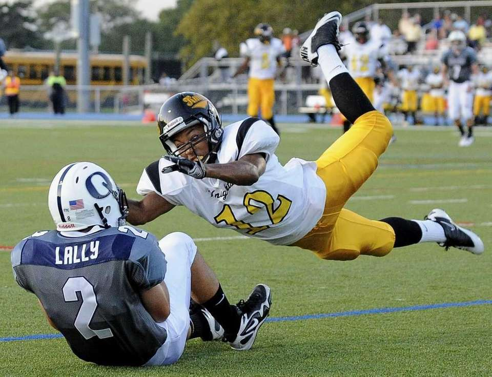 Uniondale's Richard Robinson can't stop Oceanside's Eddie Lally