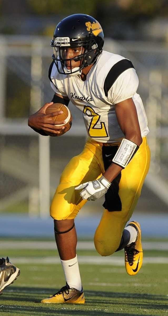 Uniondale quarterback Brandon Duncan gains yardage against Oceanside