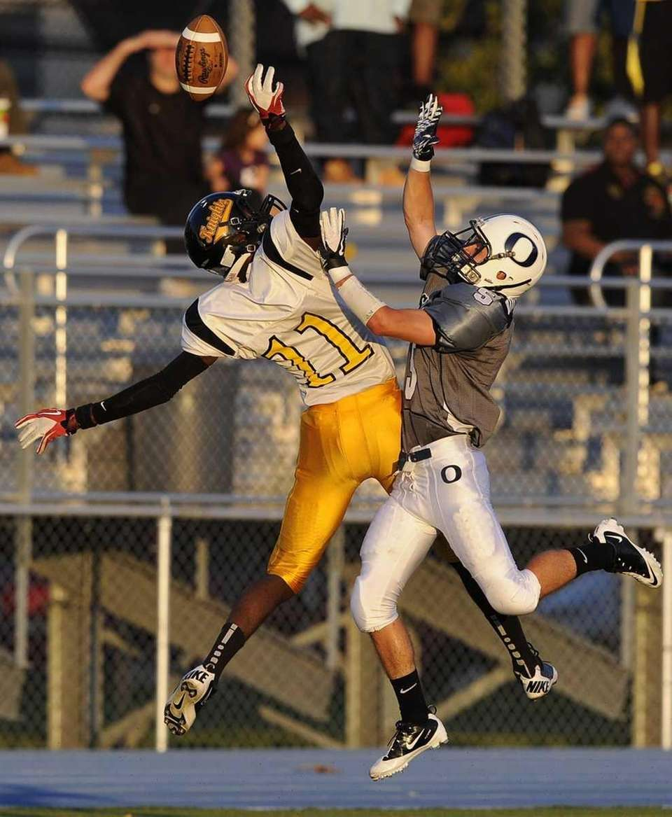 Uniondale's Kenny Woodard can't reach the ball defended