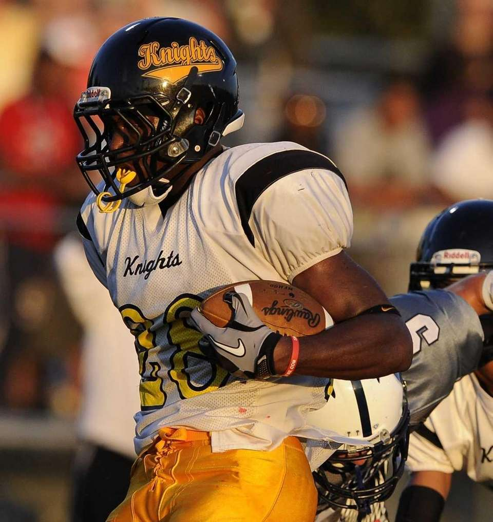 Uniondale's William Stanback scores against Oceanside in the