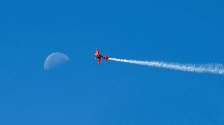 A plane flies during the second day of