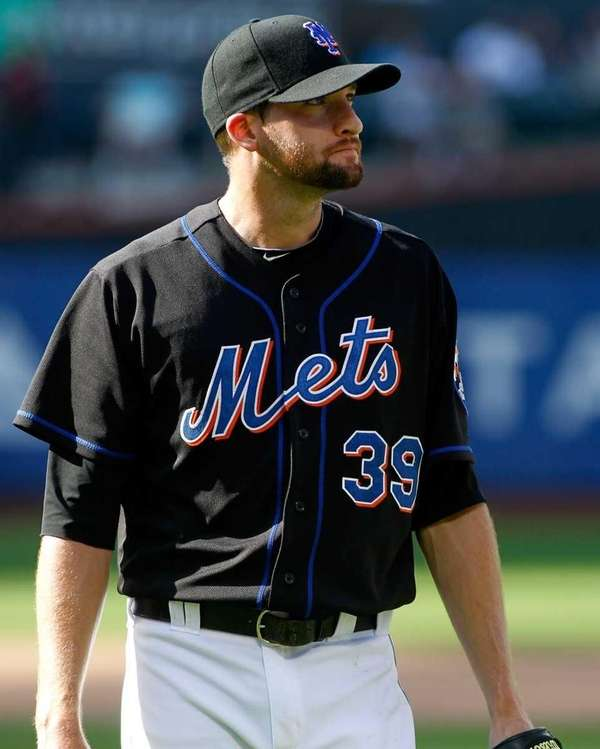 New York Mets' Bobby Parnell #39 walks back