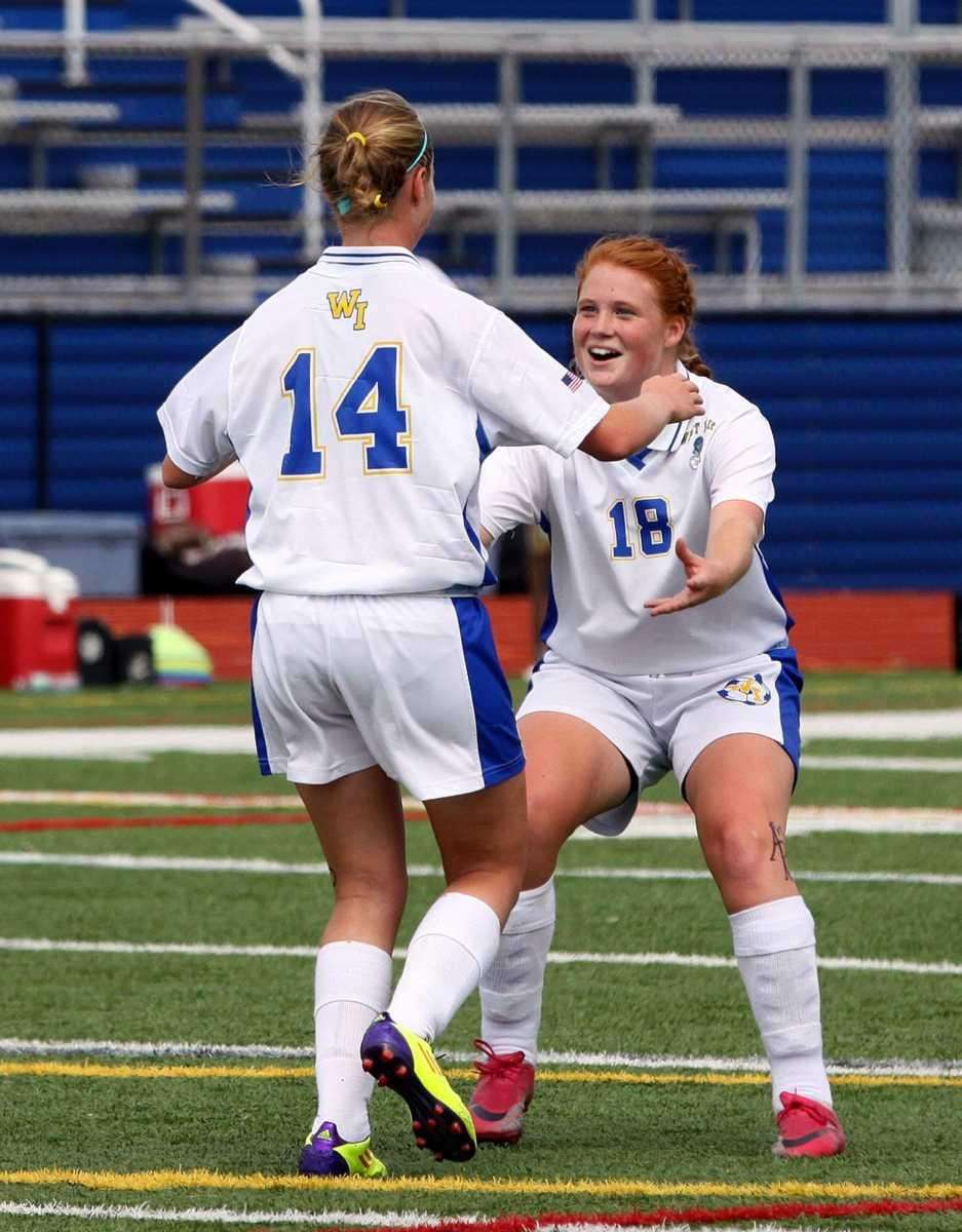 West Islip's Shannon Walter gets congratulated by teammate