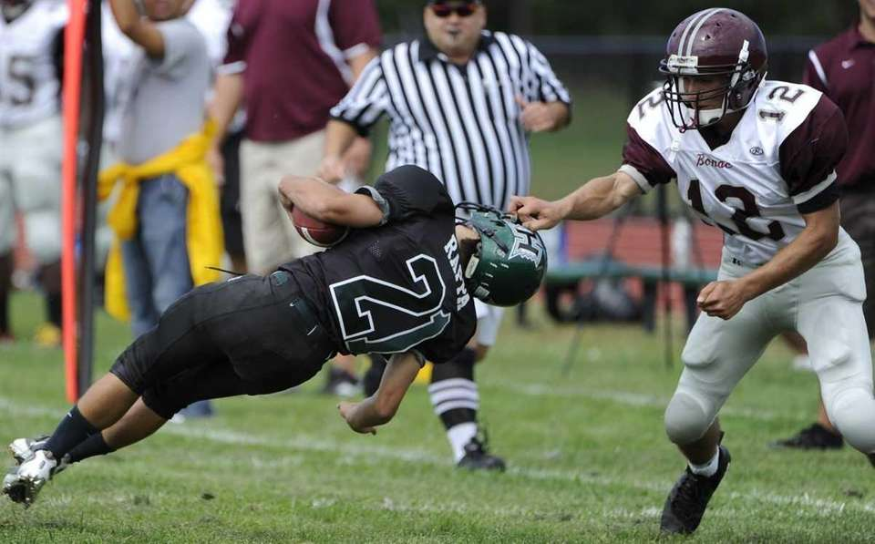 East Hampton's Ryan Judeh is called for a