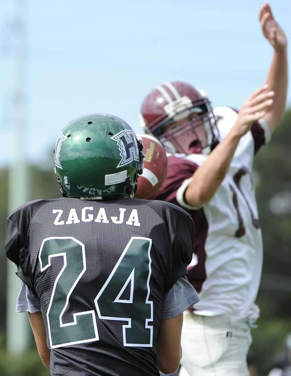Harborfields' Henry Zagaja receives the pass for a