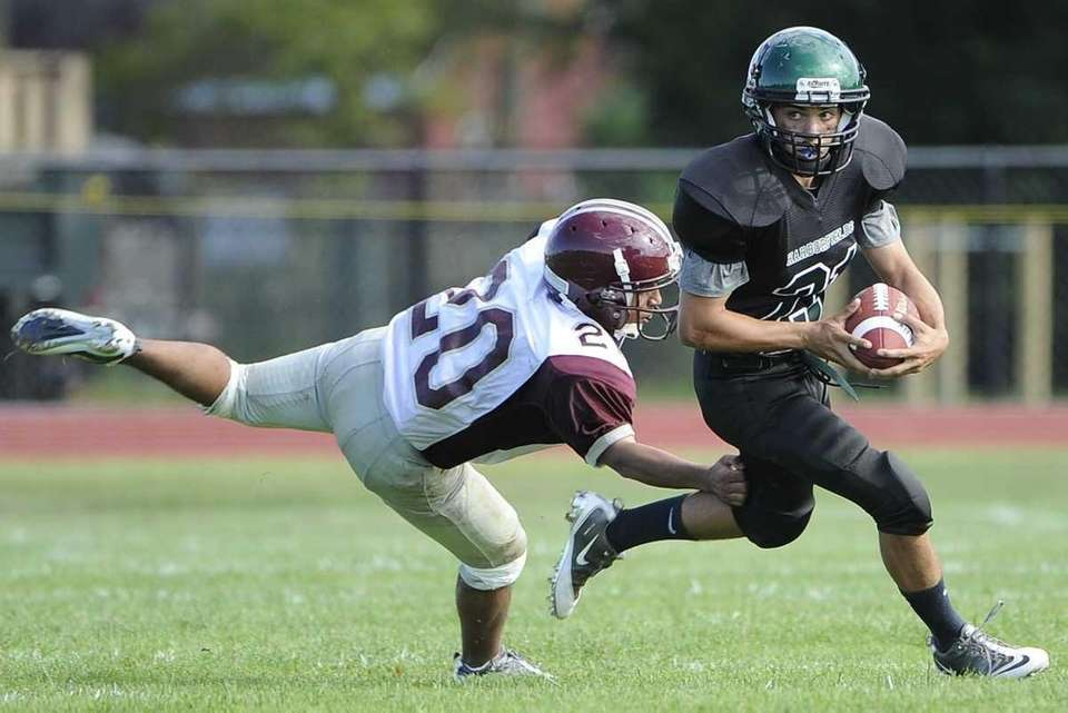 Harborfields' Alec Rappa evades a tackle by East