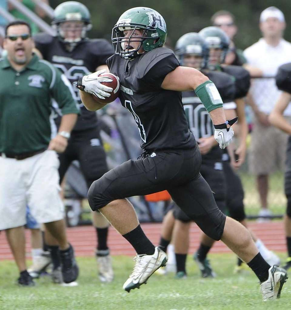 Harborfields' Connor Coyle runs for a touchdown against