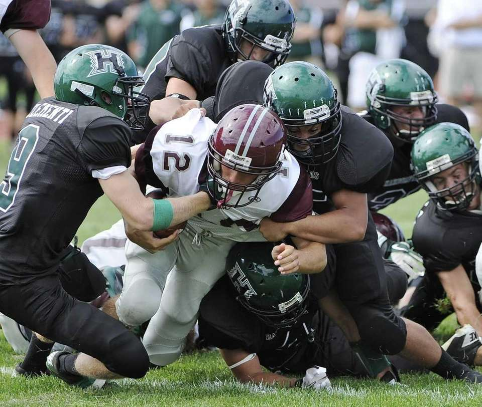 Harborfields defenders sack East Hampton quarterback Judeh Ryan