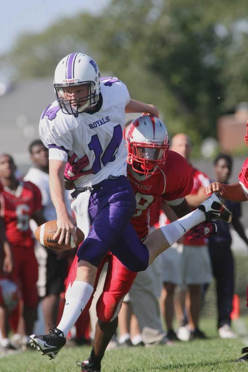 Port Jefferson's quarterback Dan Serignese is knocked out